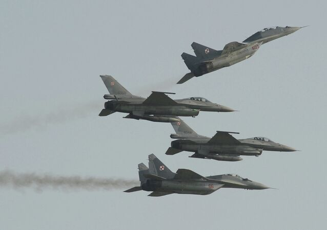 Two Polish Air Force Russian made Mig 29's fly above and below two Polish Air Force U.S. made F-16's fighter jets during the Air Show in Radom, Poland, Saturday, Aug. 27, 2011