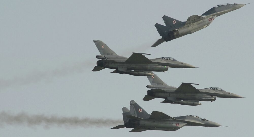 Two Polish Air Force Russian made Mig 29's fly above and below two Polish Air Force U.S. made F-16's fighter jets during the Air Show in Radom, Poland, Saturday, Aug. 27, 2011.