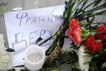People bring flowers and candles to French embassy in Moscow