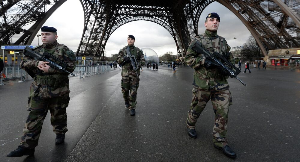 French soldiers patrol in front of the Eiffel Tower on January 8, 2015 in Paris as the capital was placed under the highest alert status a day after heavily armed gunmen shouting Islamist slogans stormed French satirical newspaper Charlie Hebdo and shot dead at least 12 people in the deadliest attack in France in four decades.