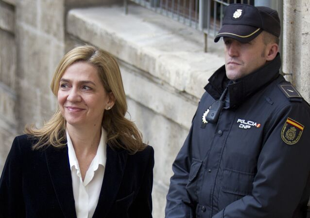 A file picture taken on February 8, 2014 shows Spanish Infanta Cristina (L) smiling as she arrives at the courthouse of Palma de Mallorca, on the Spanish Balearic Island of Mallorca. A judge on December 22, 2014 ordered the sister of Spain's King Felipe VI, Cristina, to stand trial for alleged tax fraud, a court source said, the first time a member of the Spanish royal family has been sent to the dock.