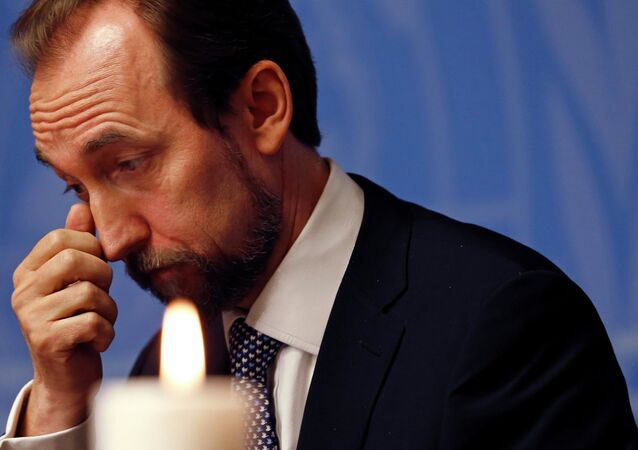 United Nations High Commissioner for Human Rights Zeid Ra'ad Al Hussein gestures behind a candle during a ceremony for the victims of the shooting at the Paris offices of French weekly newspaper Charlie Hebdo at the United Nations in Geneva January 9, 2015.