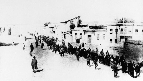 Armenian civilians escorted by Ottoman soldiers, being marched to a prison in southeastern Turkish city of Elazig, April 1915. - Sputnik International