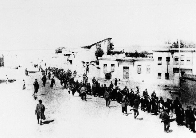 Armenian civilians escorted by Ottoman soldiers, being marched to a prison in southeastern Turkish city of Elazig, April 1915.
