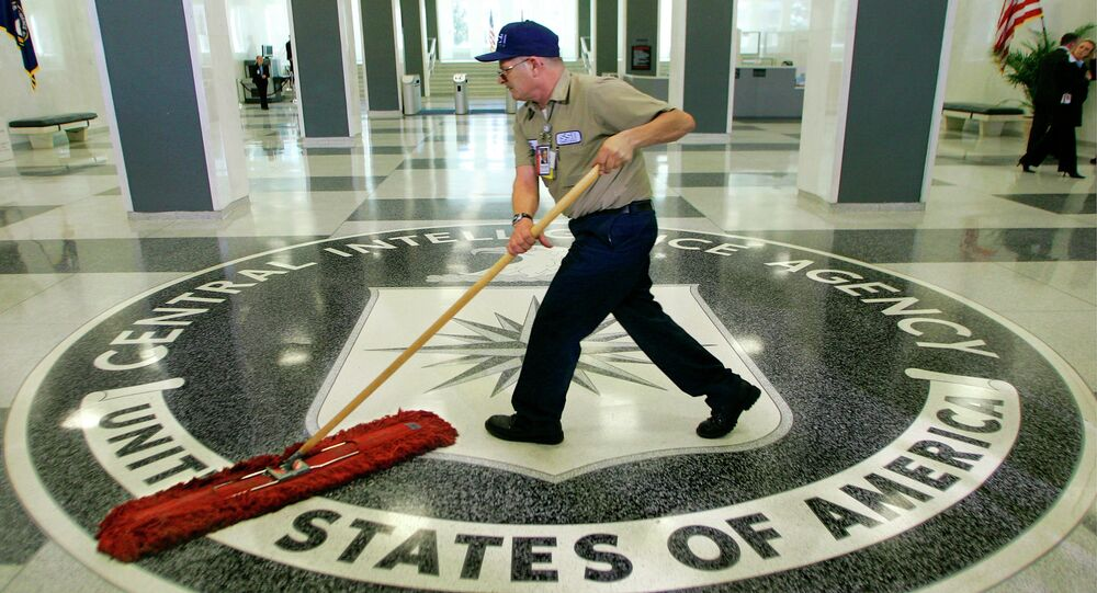 In this 2005 file photo, a workman slides a dustmop over the floor at the Central Intelligence Agency headquarters in Langley, Va., near Washington