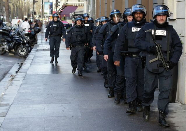 French riot police patrol in central Paris as part of the highest level of Vigipirate security plan after a shooting at the Paris offices of Charlie Hebdo January 9, 2015.