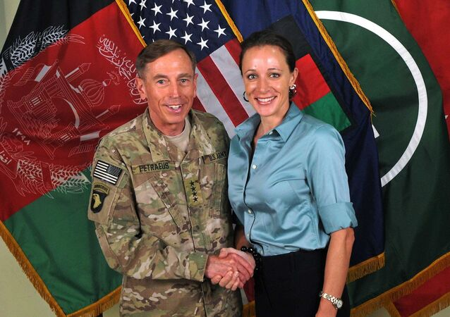 The former Commander of International Security Assistance Force and U.S. Forces-Afghanistan Gen. Davis Petraeus, left, shaking hands with Paula Broadwell, co-author of All In: The Education of General David Petraeus.