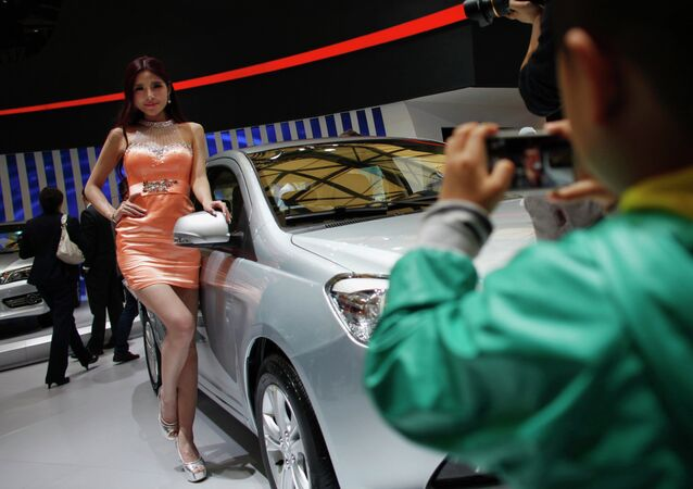 Female models in tight dresses and miniskirts may be banned from one of Asia's premier car exhibitions in Shanghai in 2015.