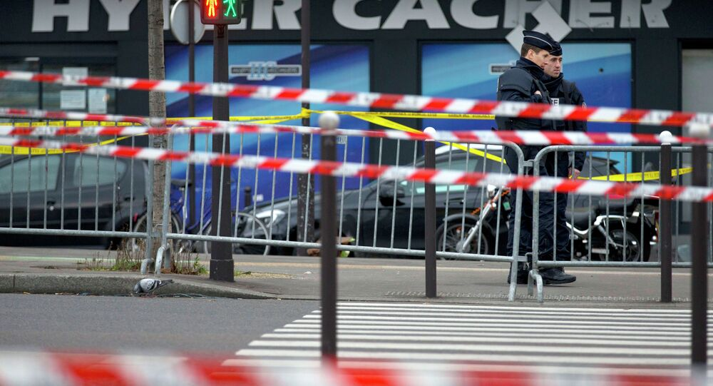 An investigation has been ordered to determine whether the man who took hostages in a kosher food store in Paris collaborated with terrorist groups during his recent stay in Madrid