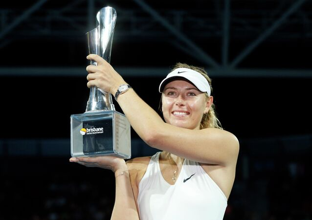 Maria Sharapova of Russia holds the Brisbane International tennis tournament women's singles trophy after defeating Ana Ivanovic of Serbia in Brisbane January 10, 2015.