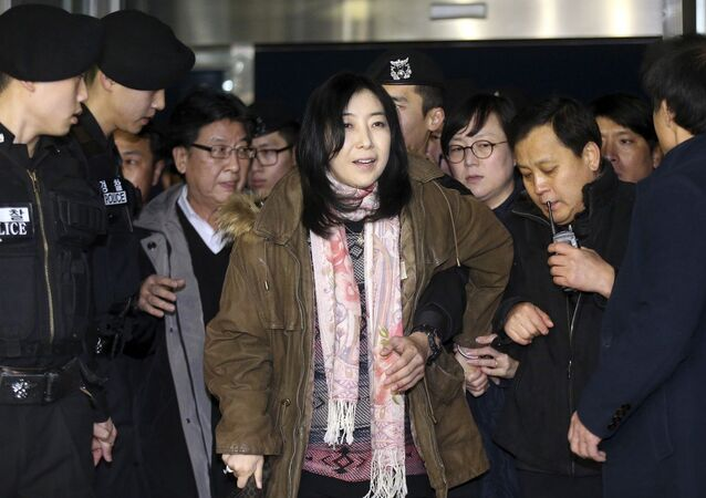 A Korean-American Shin Eun-mi, center, arrives at the Incheon International Airport for departure in Incheon, South Korea, Saturday, Jan. 10, 2015