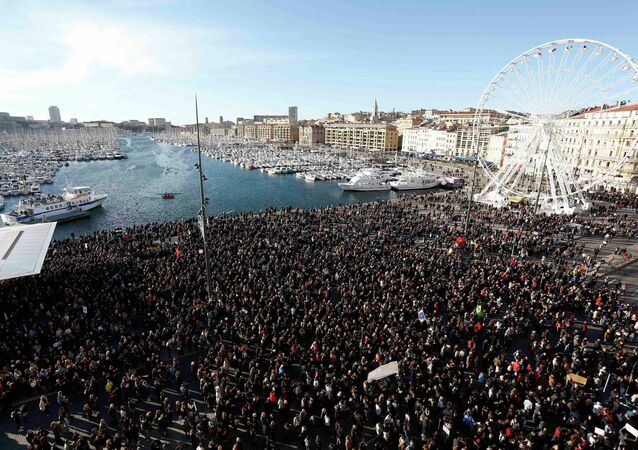 Several thousand people gather to pay tribute to victims of a shooting by gunmen at the offices of the satirical weekly newspaper Charlie Hebdo during a demonstration in Marseille, January 10, 2015