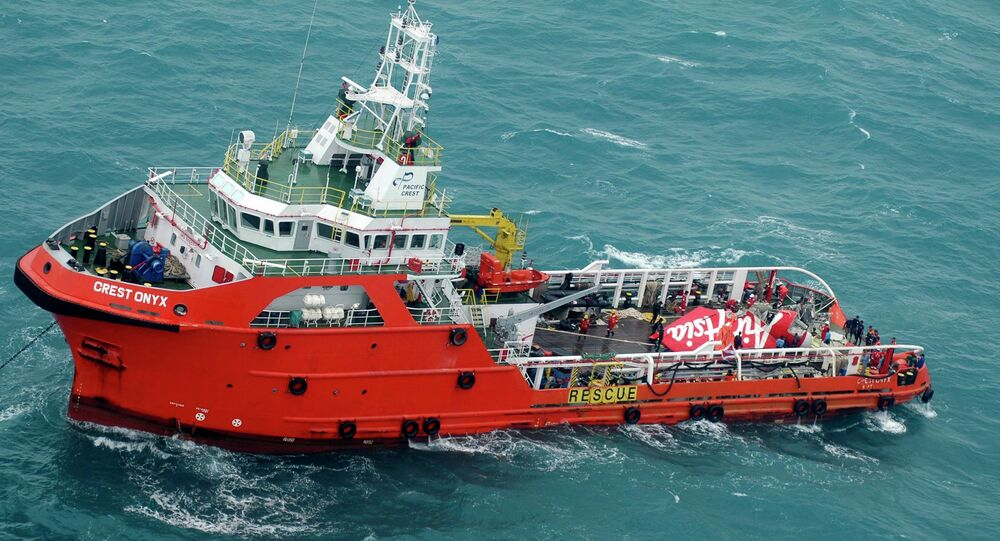 The tail of AirAsia QZ8501 passenger plane is seen on the deck of a the Indonesian Search and Rescue (BASARNAS) ship Crest Onyx after it was lifted from the sea bed, south of Pangkalan Bun, Central Kalimantan January 10, 2015.