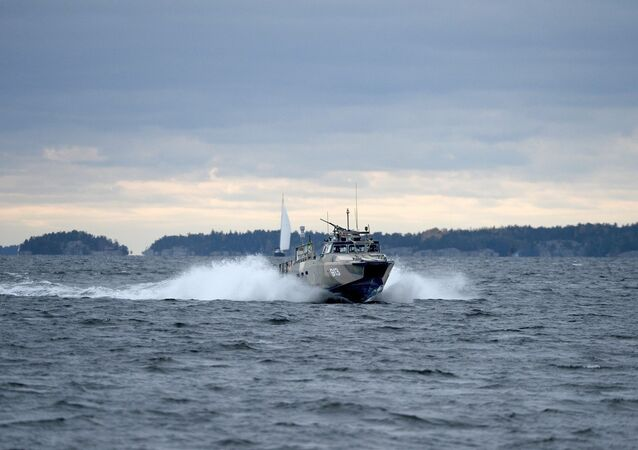 A Swedish Navy fast-attack craft cuts through the water in the the Stockholm Archipelago