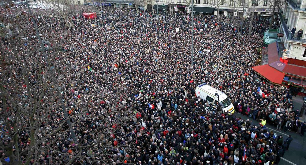 A general view shows an ambulance surrounded by hundreds of thousands of people gathering on the Place de la Republique to attend the solidarity march (Rassemblement Republicain) in the streets of Paris January 11, 2015