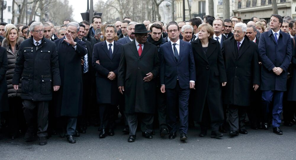 French President Francois Hollande is surrounded by head of states including (first row,LtoR) European Commission President European Commission President Jean-Claude Juncker, Israel's Prime Minister Benjamin Netanyahu, Mali's President Ibrahim Boubacar Keita, Germany's Chancellor Angela Merkel, Palestinian President Mahmoud Abbas and Italy's Prime Minister Matteo Renzi as they attend the solidarity march (Marche Republicaine) in the streets of Paris January 11, 2015