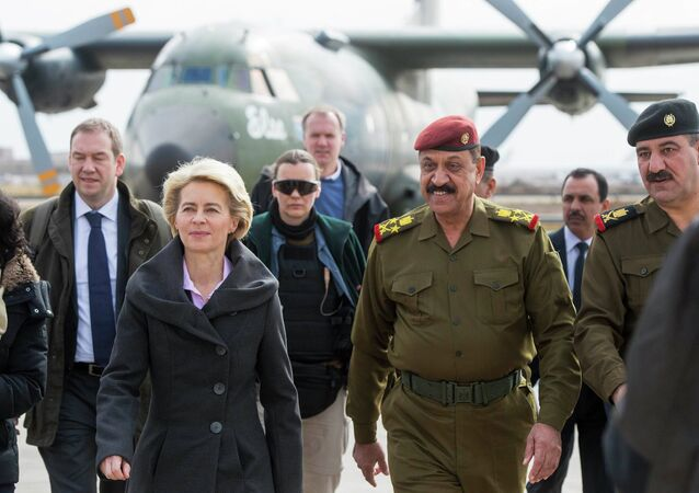 German Defence Minister Ursula von der Leyen is welcomed by Iraqi officers after landing at the airport, in Baghdad January 11, 2015