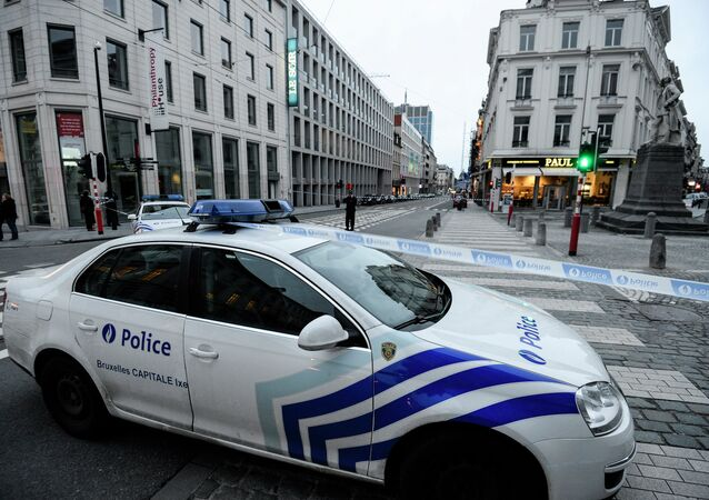 A policecar protects a security area during a bomb alert at the headquarters of Belgian newspaper Le Soir, on January 11, 2015 in Brussels