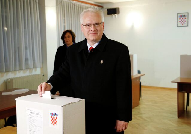 Croatian President and presidential candidate Ivo Josipovic casts his vote at a polling booth during the presidential run-off election in Zagreb