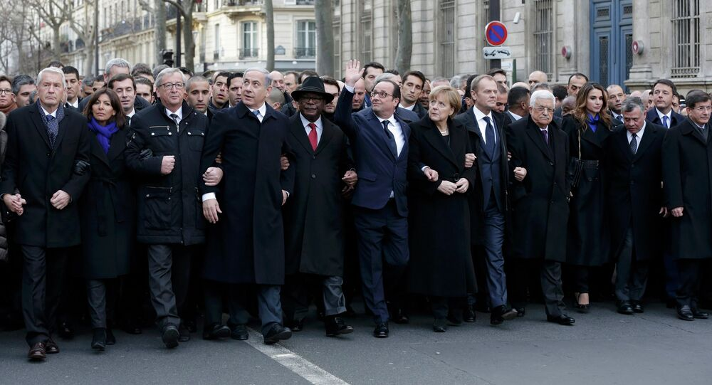 French President Francois Hollande is surrounded by Heads of state as they attend the solidarity march (Marche Republicaine) in the streets of Paris January 11, 2015.