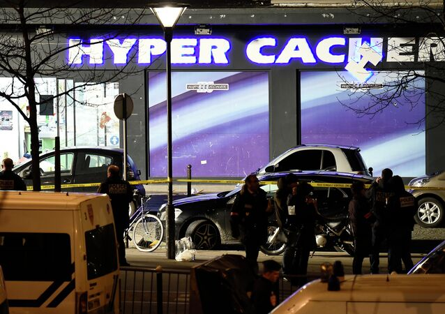 French police officers investigate the scene at the Hyper Casher kosher grocery store near Porte de Vincennes in eastern Paris after police launched an assault killing the gunman holed up in the market and freeing the hostages.