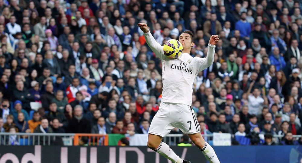 Real Madrid's Cristiano Ronaldo controls the ball during their Spanish first division soccer match against Espanyol at Santiago Bernabeu stadium in Madrid January 10, 2015.