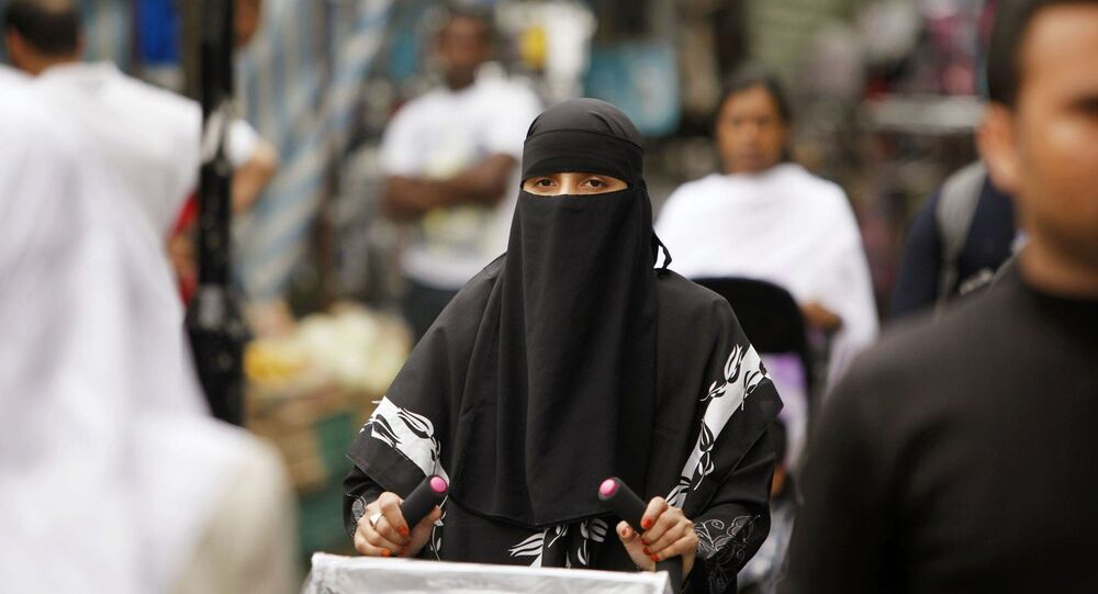 A women shops in Whitechapel, East London, she is wearing a berka / burqa.