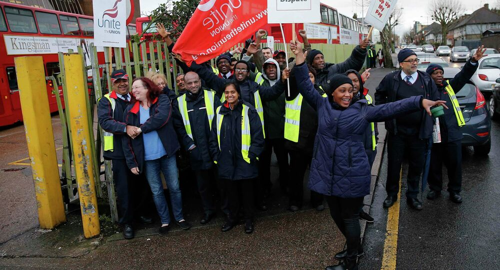Metroline bus drivers picket outside of Willesden bus depot in north west London January 13, 2015. Members of the Unite union are staging a 24-hour strike over pay and conditions, local media reported
