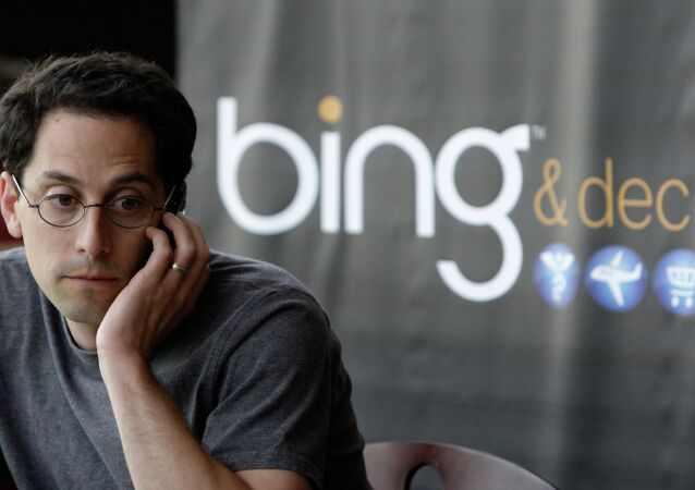 Microsoft employee Joshua Schnoll sits near a sign promoting Bing, Microsoft's recently upgraded search engine, in a company cafeteria in Redmond, Wash