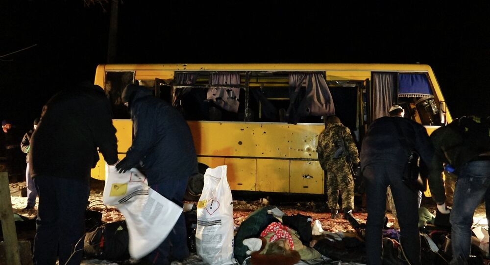 Investigators work at the site were a passenger bus was damaged by shelling, at a checkpoint of the Ukrainian forces in the village of Bugas, near the town of Volnovakha in Donetsk region, eastern Ukraine