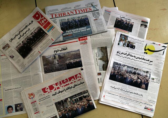 A picture taken in Tehran on January 12, 2015 shows the front pages of Iranian newspapers displaying headlines, in response to the recent Islamist attacks that killed 17 people, most at the Paris offices of satirical magazine Charlie Hebdo. More than a million people flooded Paris on Sunday in an unprecedented rally against terrorism, led by dozens of world leaders walking arm in arm as cries of Freedom and Charlie rang out.