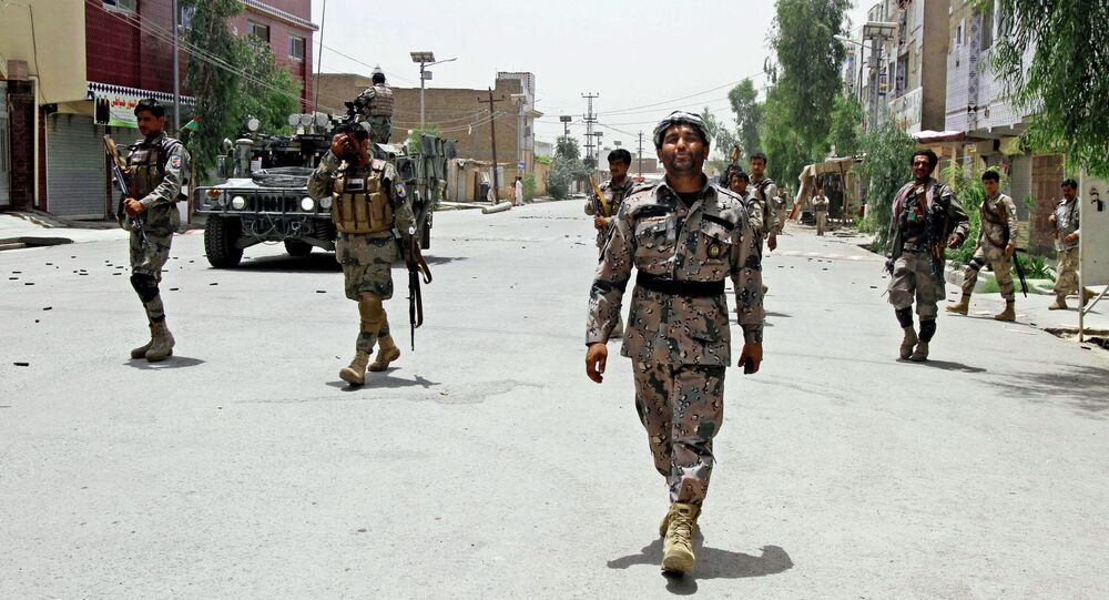Afghan forces take positions during clashes with Taliban fighters in Kandahar, southern Kabul, Afghanistan, Sunday, June 15, 2014