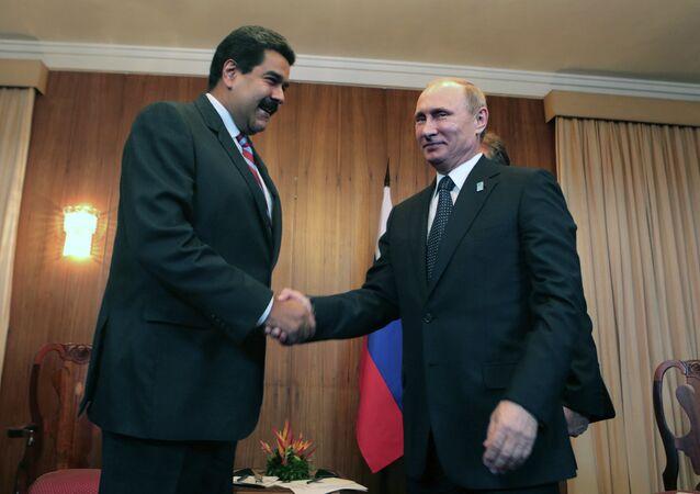 Venezuelan's Nicolas Maduro is set to meet with Russian President Vladimir Putin to discuss prospects for bilateral cooperation. Photo: Maduro and Putin meet during the BRICS-UNASUR Summit in Brasilia, Brazil, July 16, 2014
