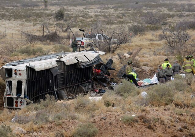 Officials investigate the scene of a prison transport bus crash in Penwell, Texas, Wednesday, Jan. 14, 2015
