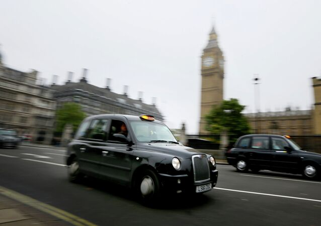 London cabs drive along Parliament Square, London, Monday, Oct. 22, 2012