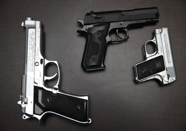 Fake guns are displayed with other prohibited carry-on items during a news conference at John. F. Kennedy Airport in New York, Tuesday, Nov. 18, 2014