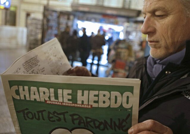 Jean Paul Bierlein reads the new Charlie Hebdo outside a newsstand in Nice, southeastern France, Wednesday, Jan. 14, 2015.