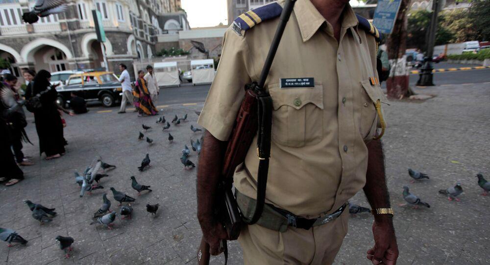 An Indian policeman patrols outside the Taj Mahal hotel in Mumbai