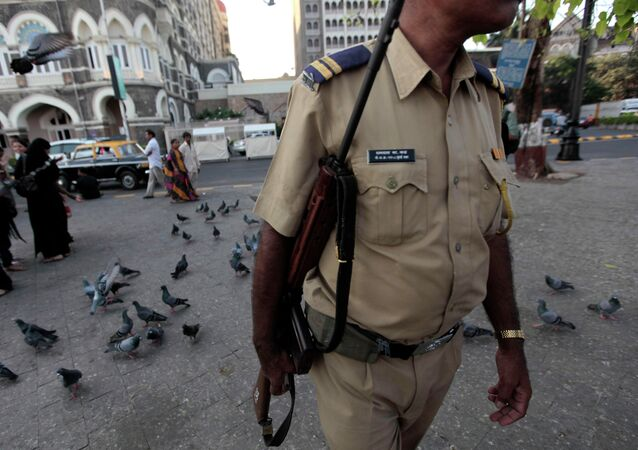 An Indian policeman patrols outside the Taj Mahal hotel in Mumbai