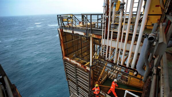 A picture shows employees working on the BP ETAP (Eastern Trough Area Project) oil platform in the North Sea, around 100 miles east of Aberdeen, Scotland on February 24, 2014 - Sputnik International