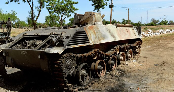 This picture taken on November 12, 2014 in front of the military base of Amchide, northern Cameroon, 1 km from Nigeria, shows a Boko Haram's tank destroyed by Cameroonian soldiers during an attack againts the military base by the Islamic fighters on October 15, 2014.
