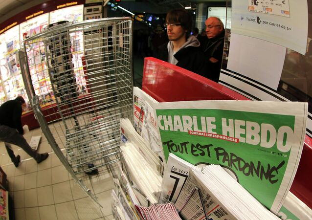 People wait to buy the latest issue of Charlie Hebdo newspaper at a newsstand in Rennes, western France, Wednesday, Jan. 14, 2015