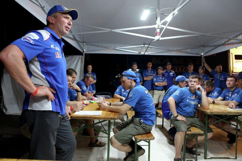 Team KAMAZ-Master captain Vladimir Chagin conducts a team meeting during the Dakar 2015 rally