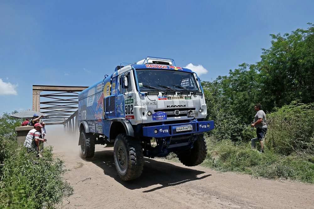 A team KAMAZ-master truck piloted by Eduard Nikolaev hops off a bridge as it speed down the road in the Dakar 2015 rally