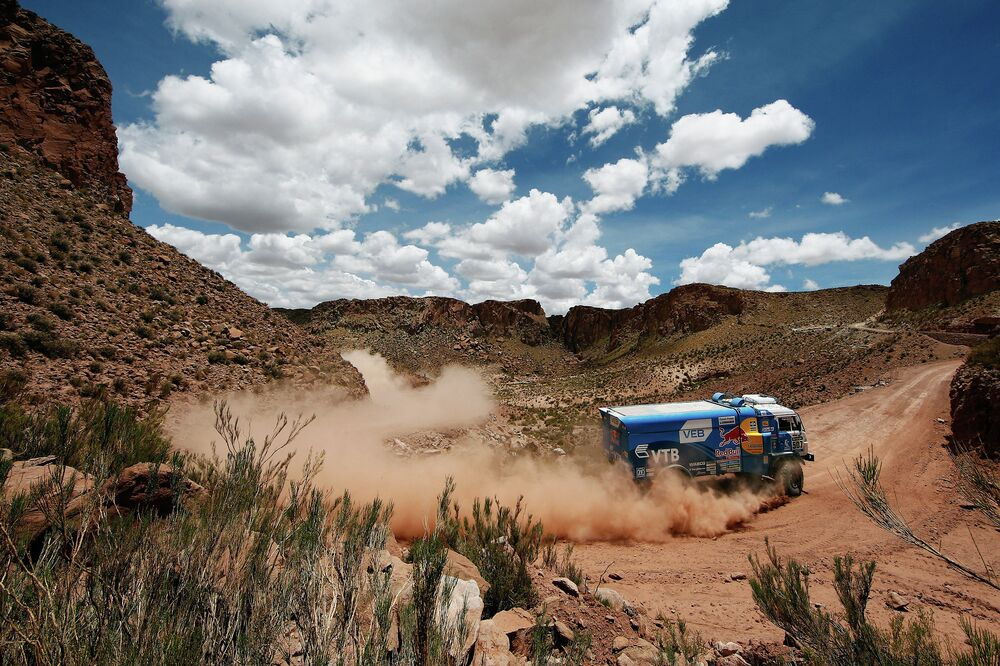 A team KAMAZ-master truck driven by Andrey Karginov drifts through a tight curve on the tenth stage of the Dakar 2015 rally