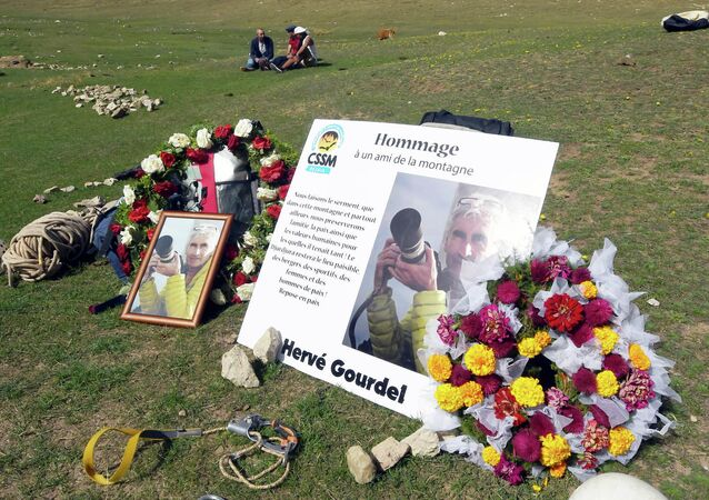 Climbers and friends of 55-year old French tourist and moutain-guide Herve Gourdel (portrait) attend a memorial in his honour on October 10, 2014 in Bouira, south of the area Gourdel was taken hostage