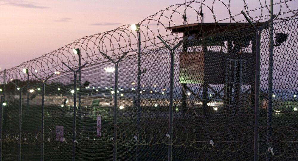 Guard tower at dawn at Camp Delta the military prison at Naval Base Guantanamo Bay Cuba