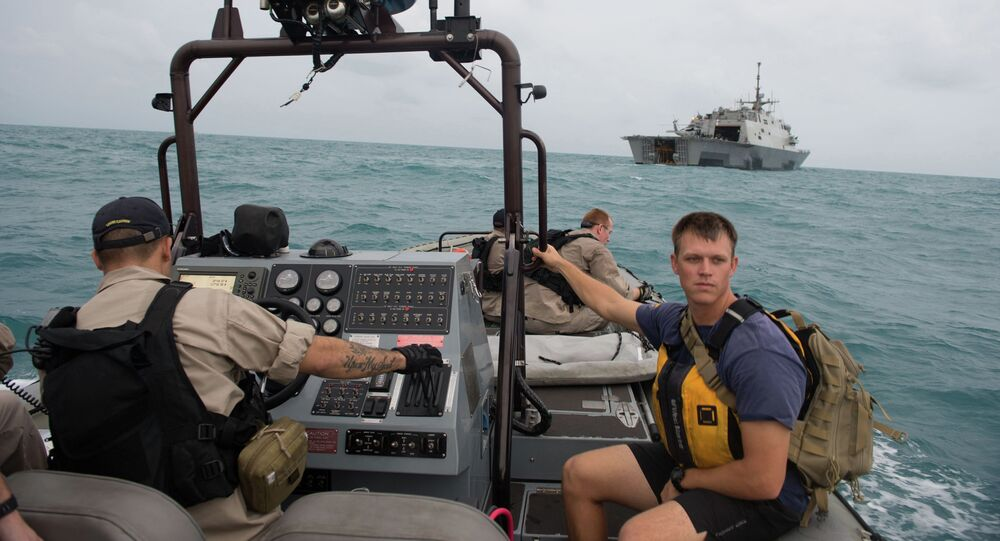 Sailors from the US Navy's USS Fort Worth searching in the Java Sea for AirAsia Flight QZ8501 make preparations to launch a Tow Fish side scan sonar system from the ship's 11-m rigid hull inflatable boat in a photo released by the US Navy January 4, 2015