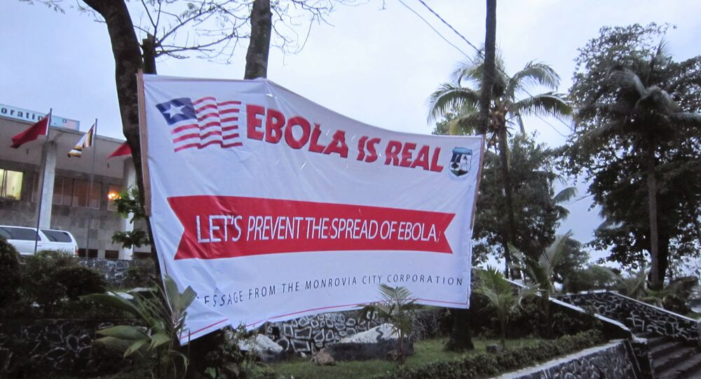 A banner reading 'Lets prevent the spread of Ebola, in front of the city hall in Monrovia, Liberia, Thursday, July 31, 2014