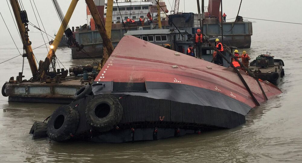 Rescue workers are seen at the site after a tug boat sank in the Yangtze River, near Jingjiang, Jiangsu province